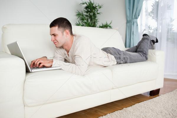 Schöner Mann Couch Notebook Wohnzimmer Computer home Stock foto © wavebreak_media