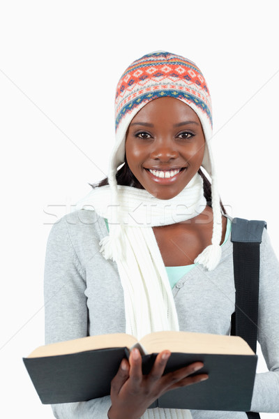 Close up of smiling student holding her book against a white background Stock photo © wavebreak_media