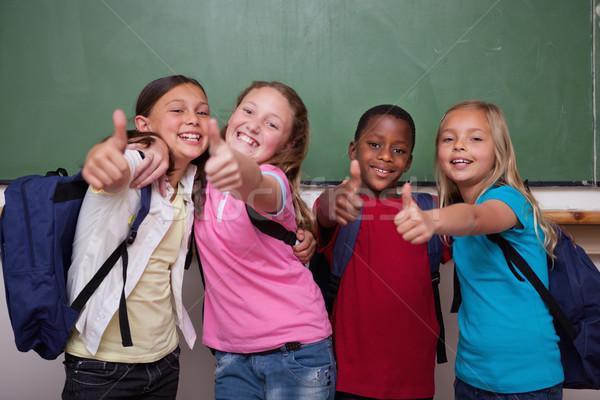 Posa pollice up classe studente Foto d'archivio © wavebreak_media