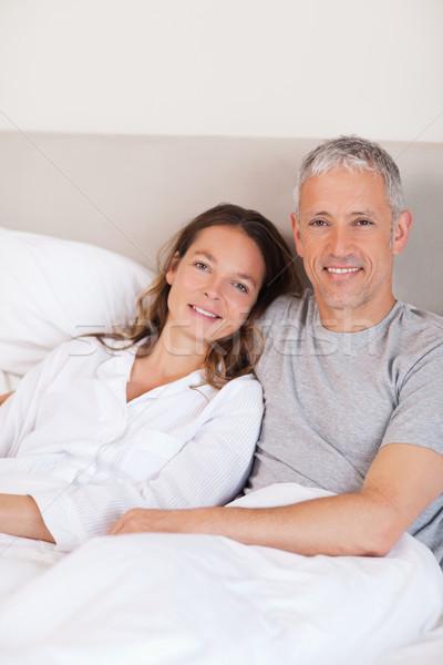 портрет пару кровать глядя камеры домой Сток-фото © wavebreak_media