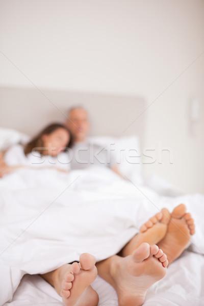Portre çift uyku kamera odak ayaklar Stok fotoğraf © wavebreak_media