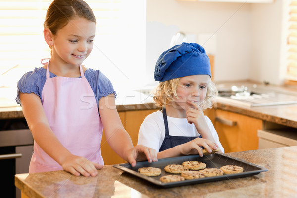 Siblings stealing cookies off the kitchen counter Stock photo © wavebreak_media