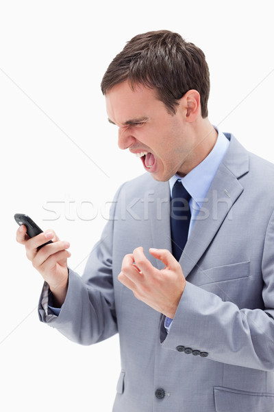 Angry businessman yelling at his cellphone against a white background Stock photo © wavebreak_media