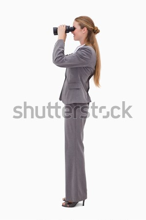 Side view of bank employee using spyglasses against a white background Stock photo © wavebreak_media
