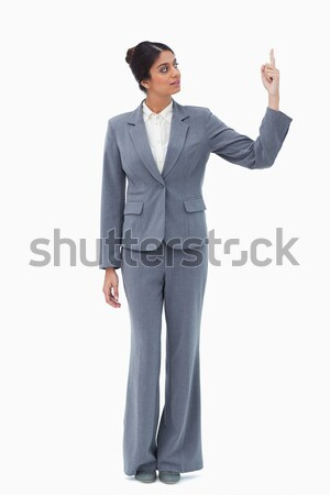 Saleswoman pointing up against a white background Stock photo © wavebreak_media