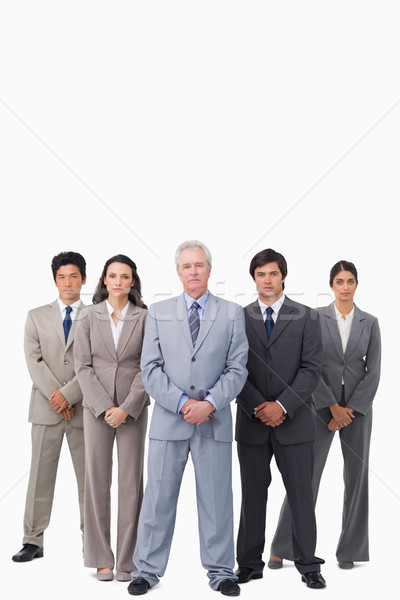 Mature salesman standing together with his team against a white background Stock photo © wavebreak_media