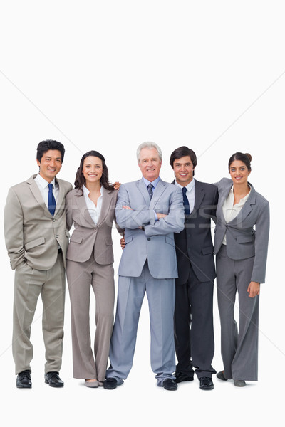 Successful senior salesman with his team against a white background Stock photo © wavebreak_media
