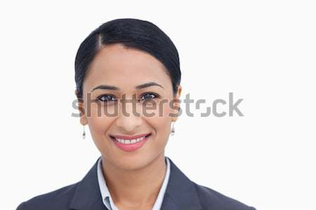Close up of smiling saleswoman against a white background Stock photo © wavebreak_media