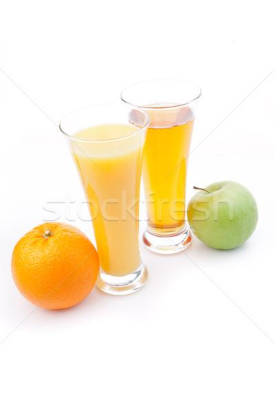 Glass of orange juice near a glass of apple juice against white background Stock photo © wavebreak_media