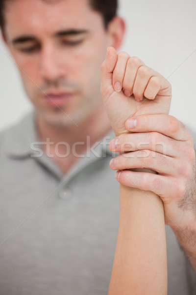 Close-up of a hand being stretched in a room Stock photo © wavebreak_media