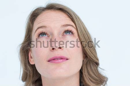 Upset blonde woman staring at the camera against a white background Stock photo © wavebreak_media