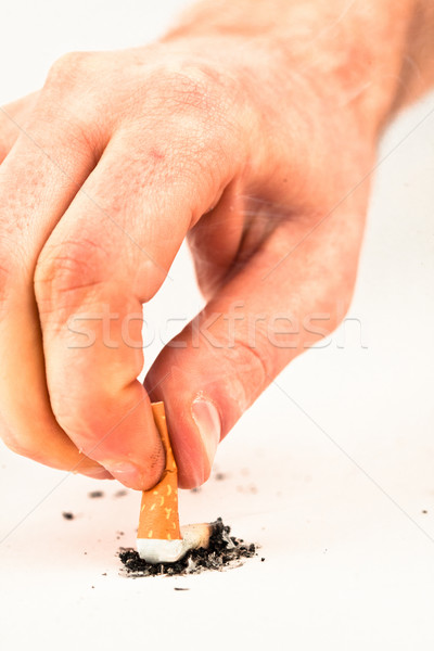 Hand extinguished a cigarette against a white background Stock photo © wavebreak_media