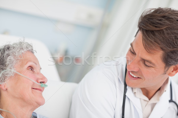 Close up of a doctor looking at a patient in hospital ward Stock photo © wavebreak_media