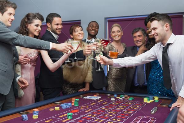 Personas pie gafas ruleta mesa dinero Foto stock © wavebreak_media
