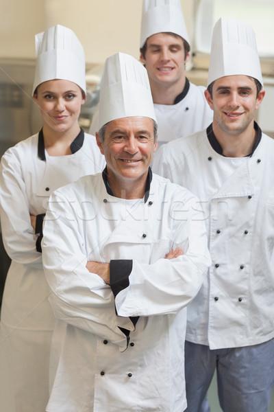 группа Повара улыбаясь Постоянный кухне работу Сток-фото © wavebreak_media