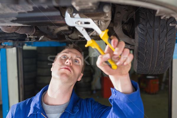 Mechanic repairing car with adjustable pliers Stock photo © wavebreak_media