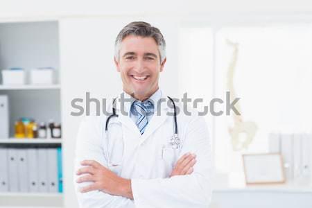 Portrait of female doctor using computer at clinic Stock photo © wavebreak_media