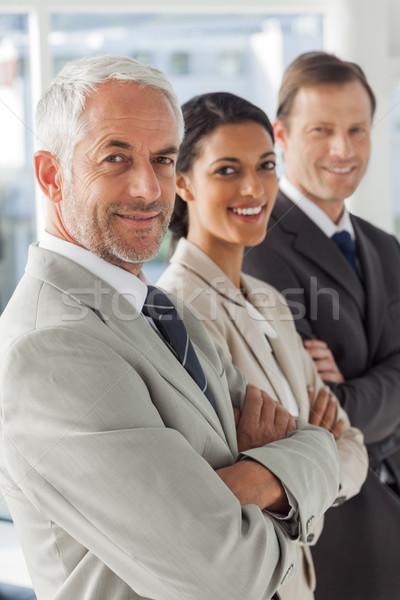 Cheerful business people looking in the same way Stock photo © wavebreak_media