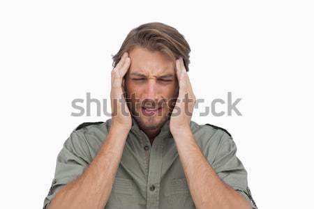 Man grimacing with pain of headache Stock photo © wavebreak_media