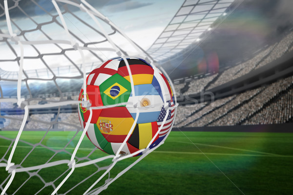 Football in multi national colours at back of net Stock photo © wavebreak_media