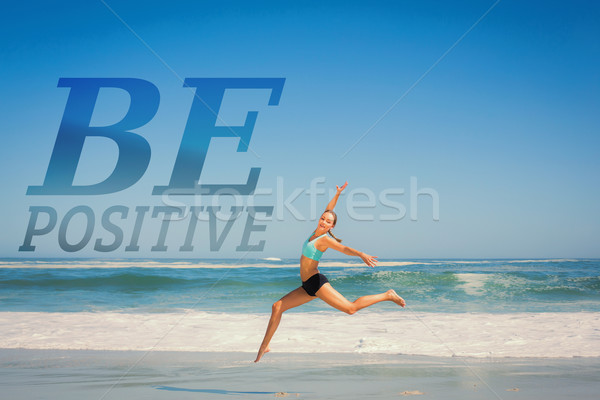 Composite image of fit woman jumping gracefully on the beach  Stock photo © wavebreak_media