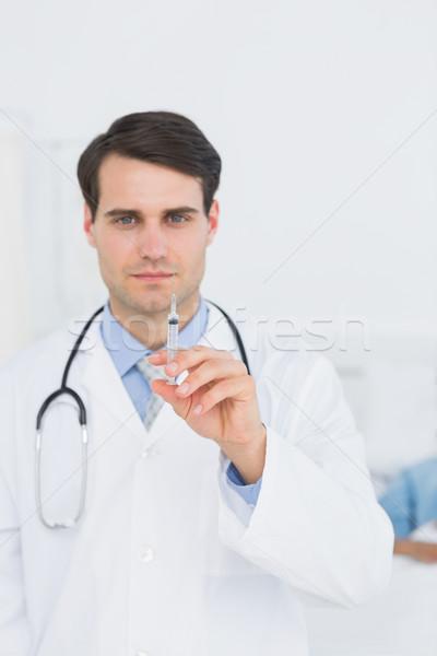 Jóképű férfi orvos tart injekció portré kórház Stock fotó © wavebreak_media