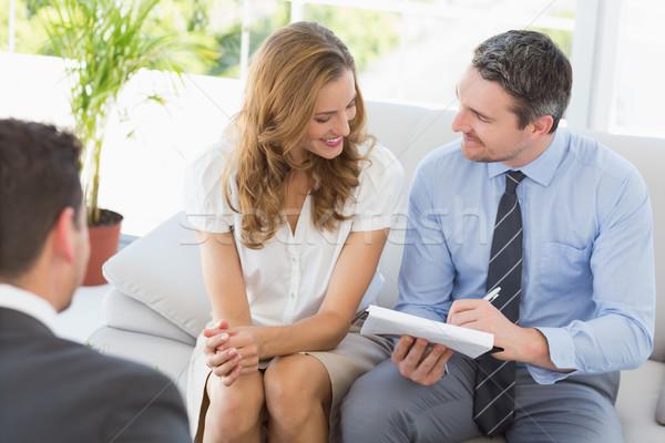 Sorridere Coppia riunione finanziaria Foto d'archivio © wavebreak_media