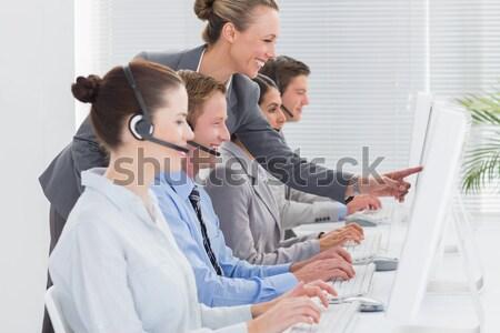 Działalności koledzy komputerów widok z boku grupy Zdjęcia stock © wavebreak_media