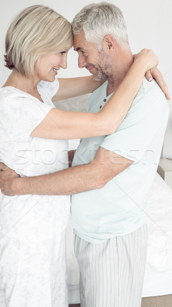 Loving mature couple with arms around Stock photo © wavebreak_media