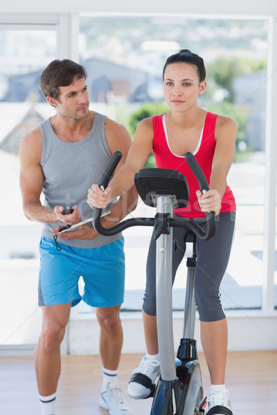 Fit woman with male instructor working out at spinning class Stock photo © wavebreak_media