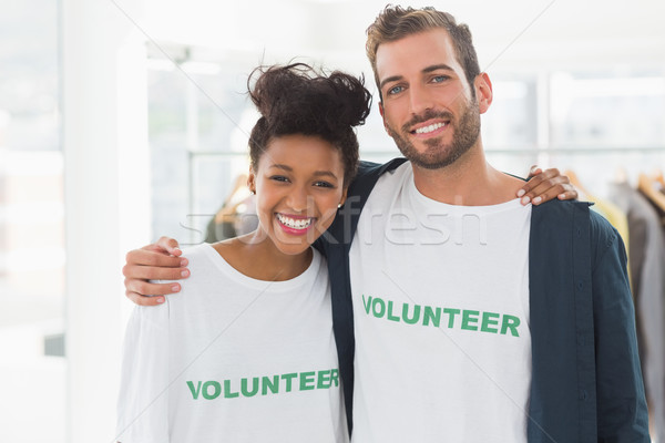 Portrait of two young volunteers with arms around Stock photo © wavebreak_media