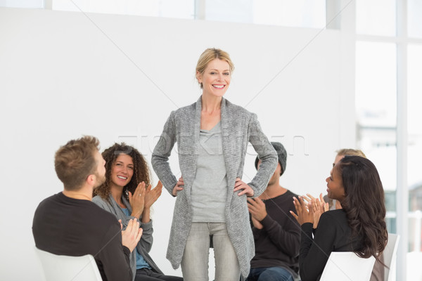Rehab group applauding woman standing up Stock photo © wavebreak_media