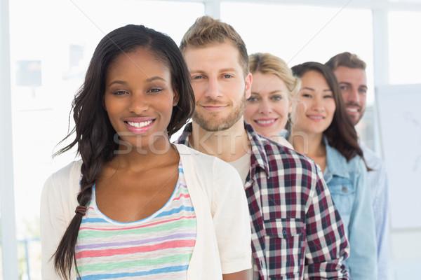 Diverso projeto equipe em pé linha sorridente Foto stock © wavebreak_media