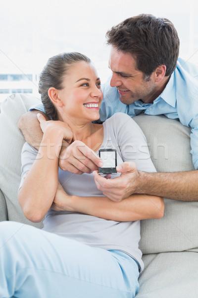 Boldog nő meglepődött javaslat otthon nappali Stock fotó © wavebreak_media