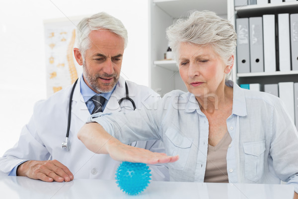 Male doctor with senior patient using stress buster ball Stock photo © wavebreak_media