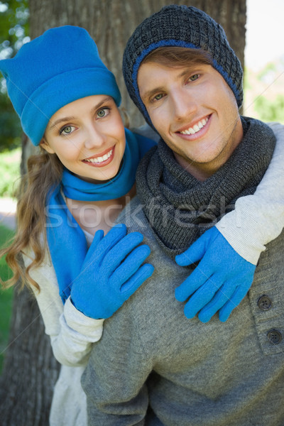 Cute couple embracing in the park smiling at camera Stock photo © wavebreak_media
