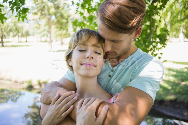 Affectionate young couple standing together in the park Stock photo © wavebreak_media
