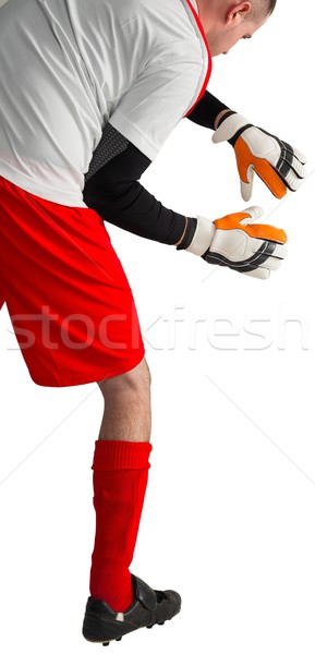 Goalkeeper in red and white ready to catch Stock photo © wavebreak_media