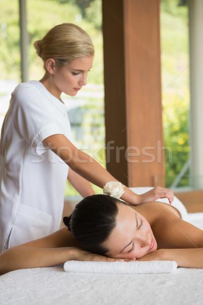 Brunette enjoying a peaceful massage with eyes closed Stock photo © wavebreak_media