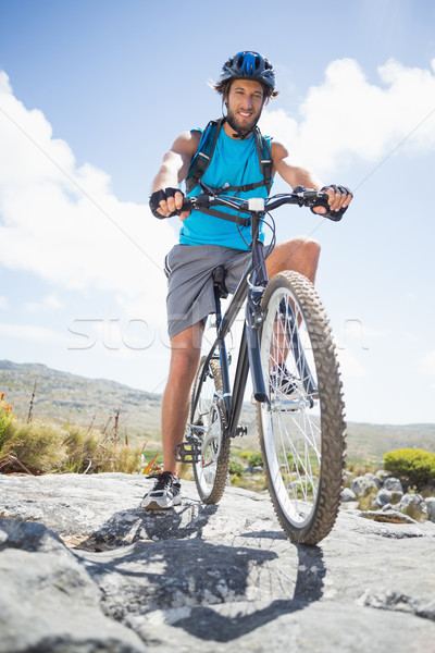 Fit man cycling on rocky terrain Stock photo © wavebreak_media