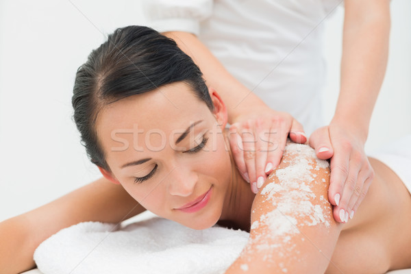 Peaceful brunette getting a salt scrub beauty treatment Stock photo © wavebreak_media
