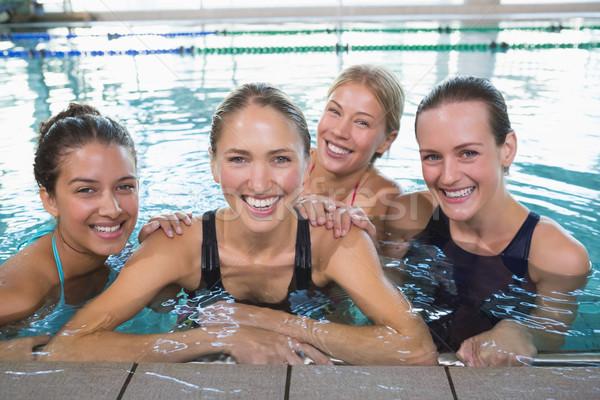 Female fitness class smiling at camera Stock photo © wavebreak_media