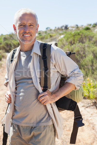 Guapo caminante sonriendo cámara Foto stock © wavebreak_media