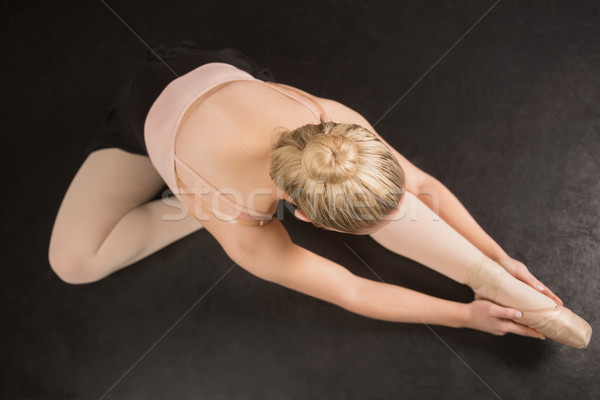 Ballerina sitting and bending forward Stock photo © wavebreak_media