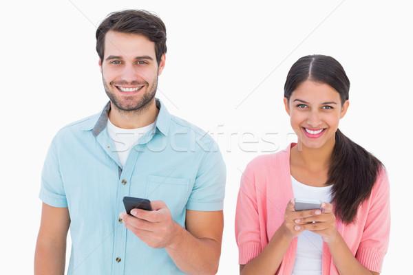 Boldog pár küldés szöveges üzenetek fehér női Stock fotó © wavebreak_media