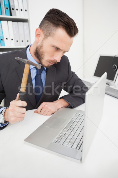 Angry businessman holding hammer over laptop Stock photo © wavebreak_media