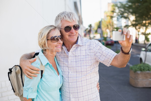 Happy tourist couple taking a selfie in the city Stock photo © wavebreak_media
