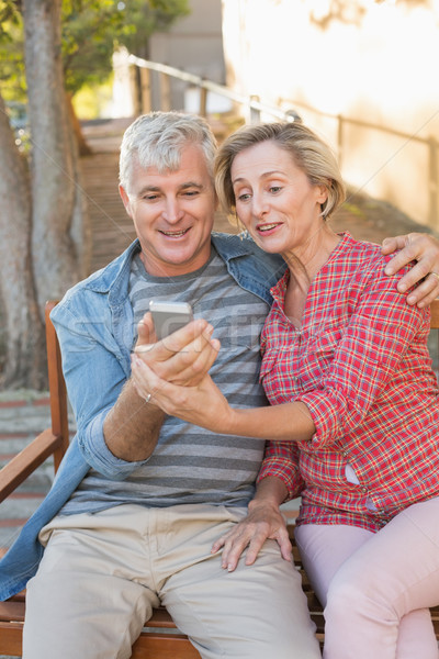 Happy mature couple taking a selfie together in the city Stock photo © wavebreak_media