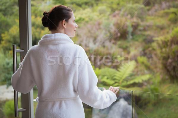 Vrouw badjas wazig planten achteraanzicht Stockfoto © wavebreak_media