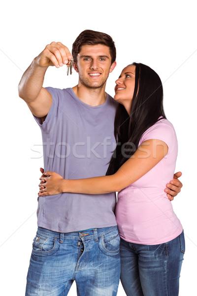 Young couple showing keys to house Stock photo © wavebreak_media
